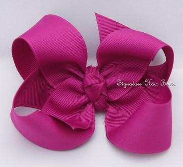 festive fuschia hair bow